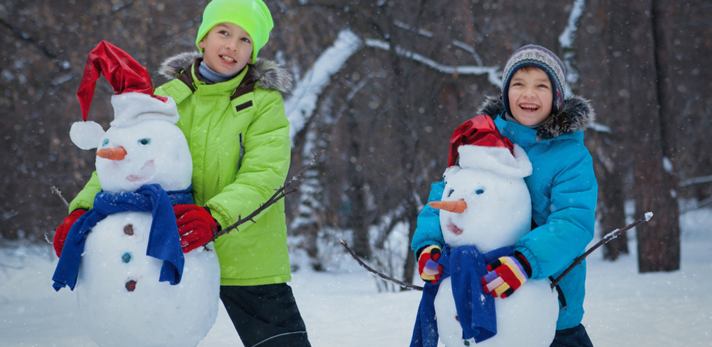 JOYFUL boys with snowman